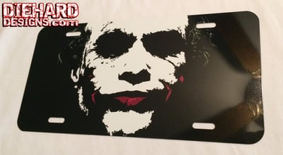 Heath's Joker™ from The Dark Knight Trilogy™ - Vanity License Plate w/ FREE GROUND SHIPPING!*